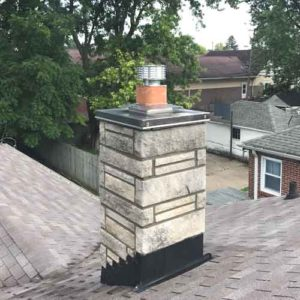 finished tuck pointed stone chimney